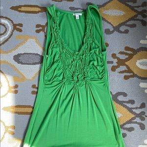 Sleeveless stretch green top with detailed front